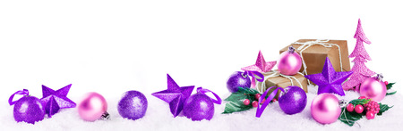 Christmas lantern with gifts, colored balls and stars on snow isolated background. Christmas background concept