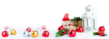 Christmas lantern with gifts, colored balls and Santa Claus on snow isolated background. Christmas background concept