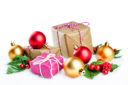 Christmas winter background with gifts, colored balls and christmas branches. Christmas background concept