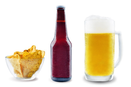 Light beer with corn chips on a white background. toning. selective focus Stock Photo