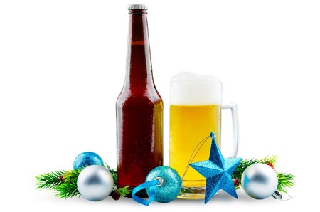 Beer in bottle and in glass with Christmas decoration isolated. toning. selective focus Stock Photo