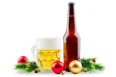 Beer in bottle and in glass with Christmas decoration isolated. toning. selective focus 版權商用圖片