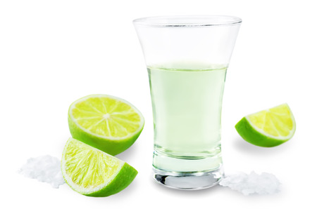 Glass of tequila liquor with salt and lime fruits isolated 版權商用圖片