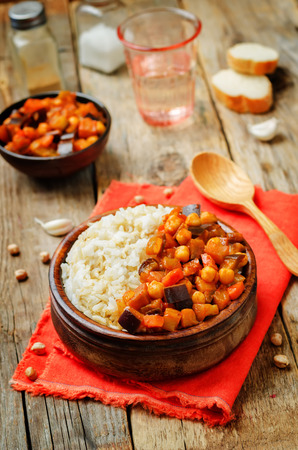 Eggplant and tomato chickpea curry with rice. toning. selective focus