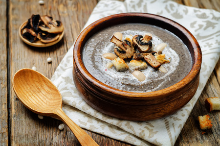 White bean mushrooms soup with croutons. toning. selective focus Stock Photo