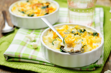 Chicken Spinach Cauliflower casserole on a wood background. toning. selective focus