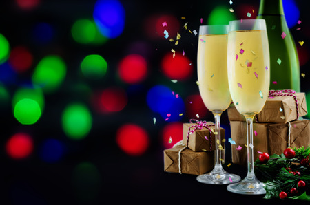 Champagne in in glasses with Christmas decoration on a shiny background. toning. selective focus