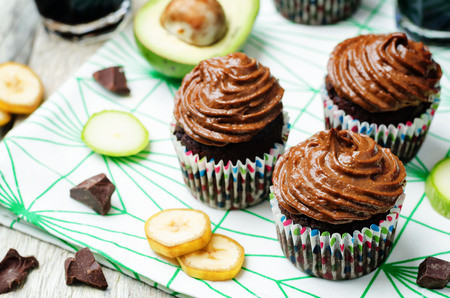 Chocolate zucchini banana cupcakes with chocolate avocado banana peanut butter cream frosting. toning. selective focus