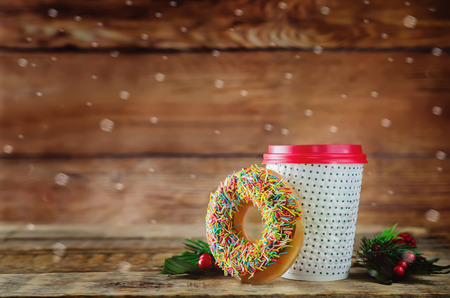 Donut with coffee on a wood background. toning. selective focus 写真素材