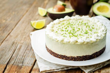avocado lime cheesecake on a wood background. toning. selective focus