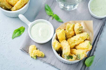 Baked Zucchini Fries with Pesto Greek yogurt sauce. toning. selective focus Stok Fotoğraf
