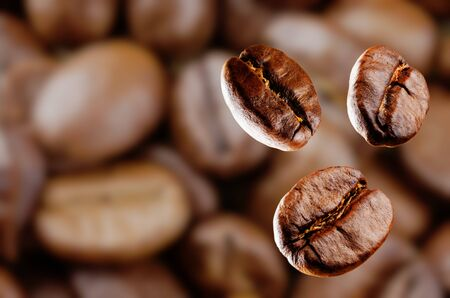 Coffee beans on blurred background. Selective focus