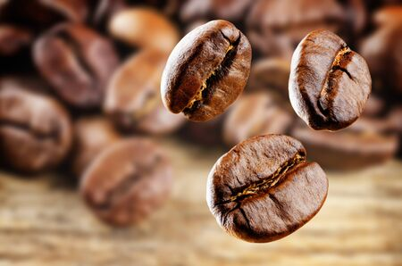 Coffee beans on a dark wood background.  Selective focus