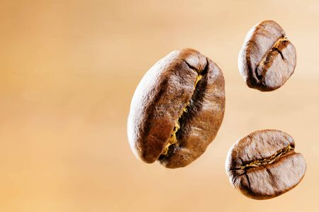 Coffee beans on light background. Selective focus