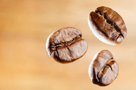 Coffee beans on light background.  Selective focus 版權商用圖片