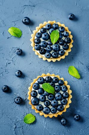 Blueberry tartlets with fresh berries and mint leaves. Selective focus Stock fotó