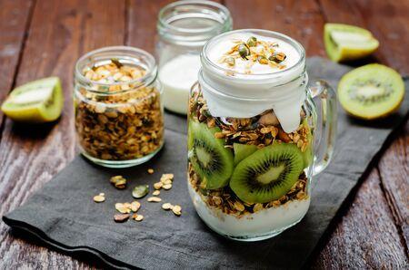 Greek yogurt granola kiwi breakfast in jar. Zdjęcie Seryjne