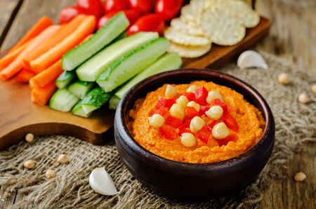 Red bell pepper hummus with vegetables.  Toning. Selective focus