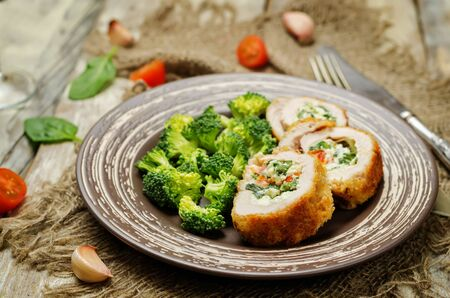 Ricotta tomato spinach stuffed turkey with broccoli. toning. selective focus