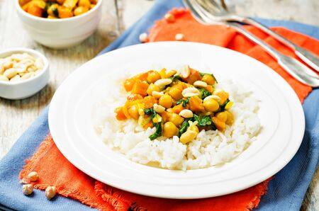 Sweet potato spinach chickpea curry with rice. toning. selective focus Imagens