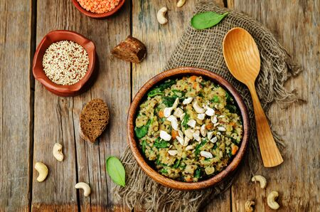 lentils mushroom spinach quinoa with fresh spinach leaves and cashews. toning. selective Focus