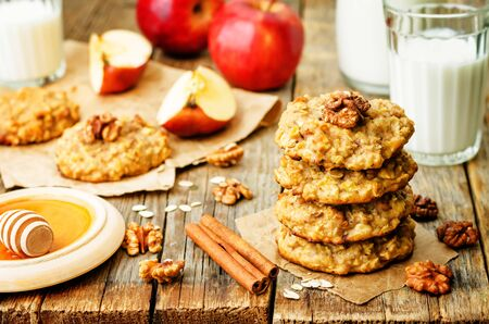 apples oats cinnamon cookies on a wood background. the toning. selective focus Stock Photo