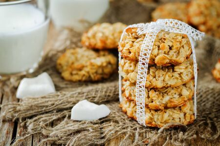 Oatmeal coconut cookies on a wood background. toning. selective focus