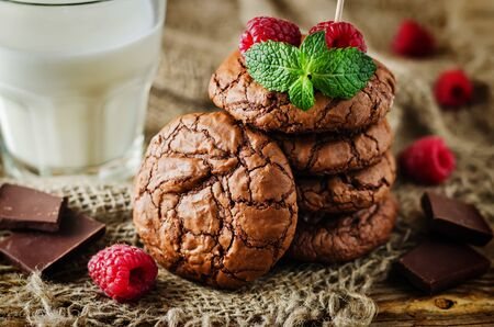 Chocolate brownie cookies with berries and mint leaves. the toning. selective focus