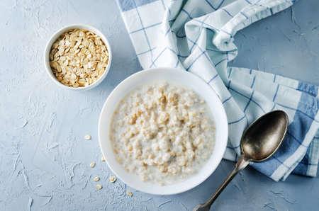 Oatmeal porridge with oats. toning. selective focus