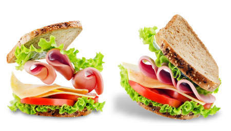 Sandwich with whole grain bread, salad, cheese, tomato and ham on a white isolated background. toning