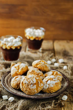 Pumpkin cookies with cups of coffee and marshmallow. toning. selective focus