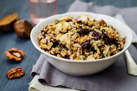 Eggplant quinoa apples dried cranberry salad. toning. selective focus