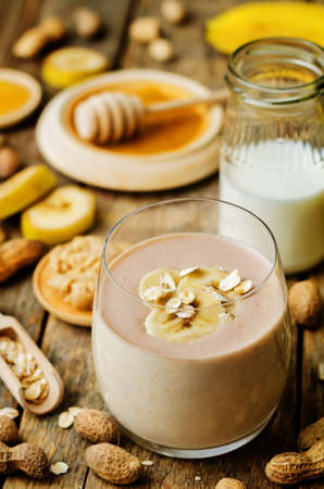 peanut butter smoothie with milk, chocolate, apples, banana and oats. the toning. selective focus