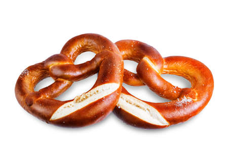 Pretzel with salt on a white isolated background. toning. selective focus