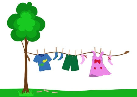 Small boy and girl clothes drying pinned with clothespins to the rope after laundry