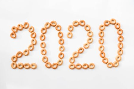 2020 made of cookies on a white background. christmas background for lettering Stock Photo