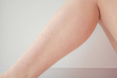 unshaven, hairy legs of a woman before hair removal. concept of smooth skin without hair, spa concept