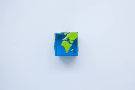 earth square globe on white background. Mock up. Flat lay composition.