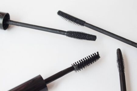 Set of mascara brushes on a white background. spa and makeup concept. Top view. Flat lay composition.