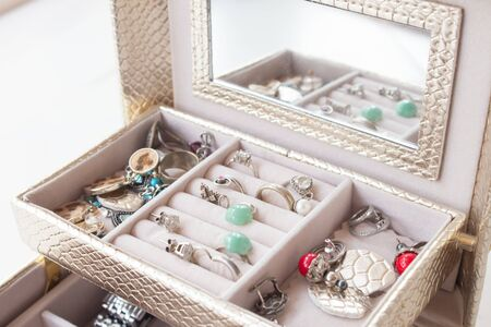 luxurious casket with drawers and silver jewelry, precious stones, pearls