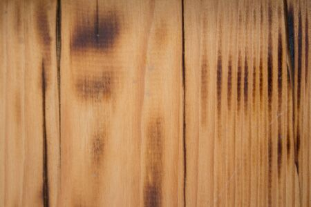 burned, old wood texture. wall textured background pattern.