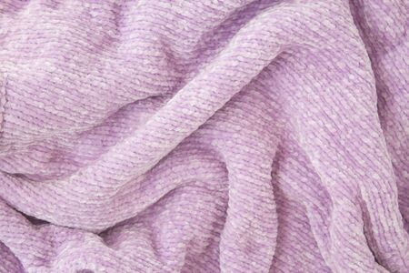 Lilac fabric with large knitted fibers closeup background.