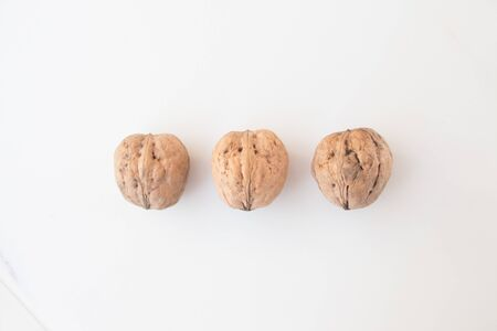 Walnuts on a white background close-up. The concept of vegan and vegetarian. Getting Vitamins from Nuts.
