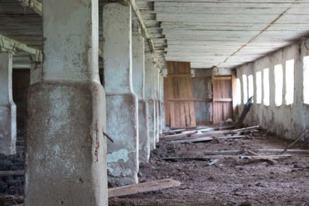 Abandoned building with columns. The gloomy place was empty and dilapidated, windows and doors.