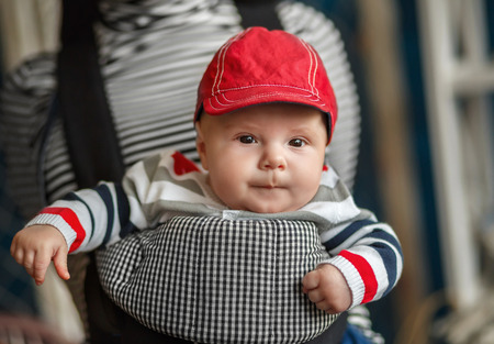 ergonomic: Portrait of a baby sitting in an ergonomic baby carrier
