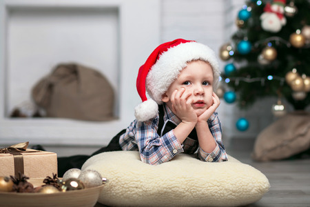 to expect: Little boy in Christmas decorations expect a miracle
