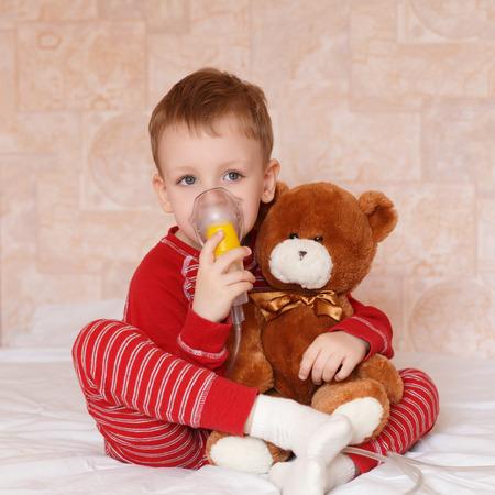 inhalation: Sick child makes himself inhalation mask for breathing at home