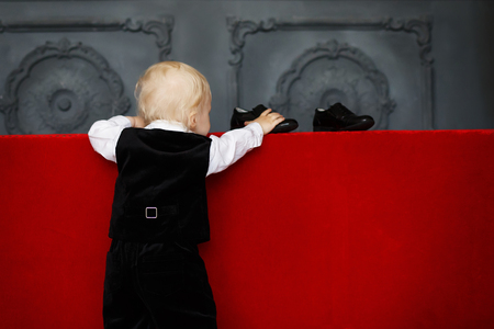 patent leather: Smart Little baby boy trying to wear patent leather shoes