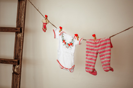 toys pattern: Things for the newborn girl hanging on rope