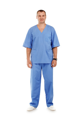 urologist: Full length portrait of a young male doctor in a medical surgical blue uniform against a white background Stock Photo